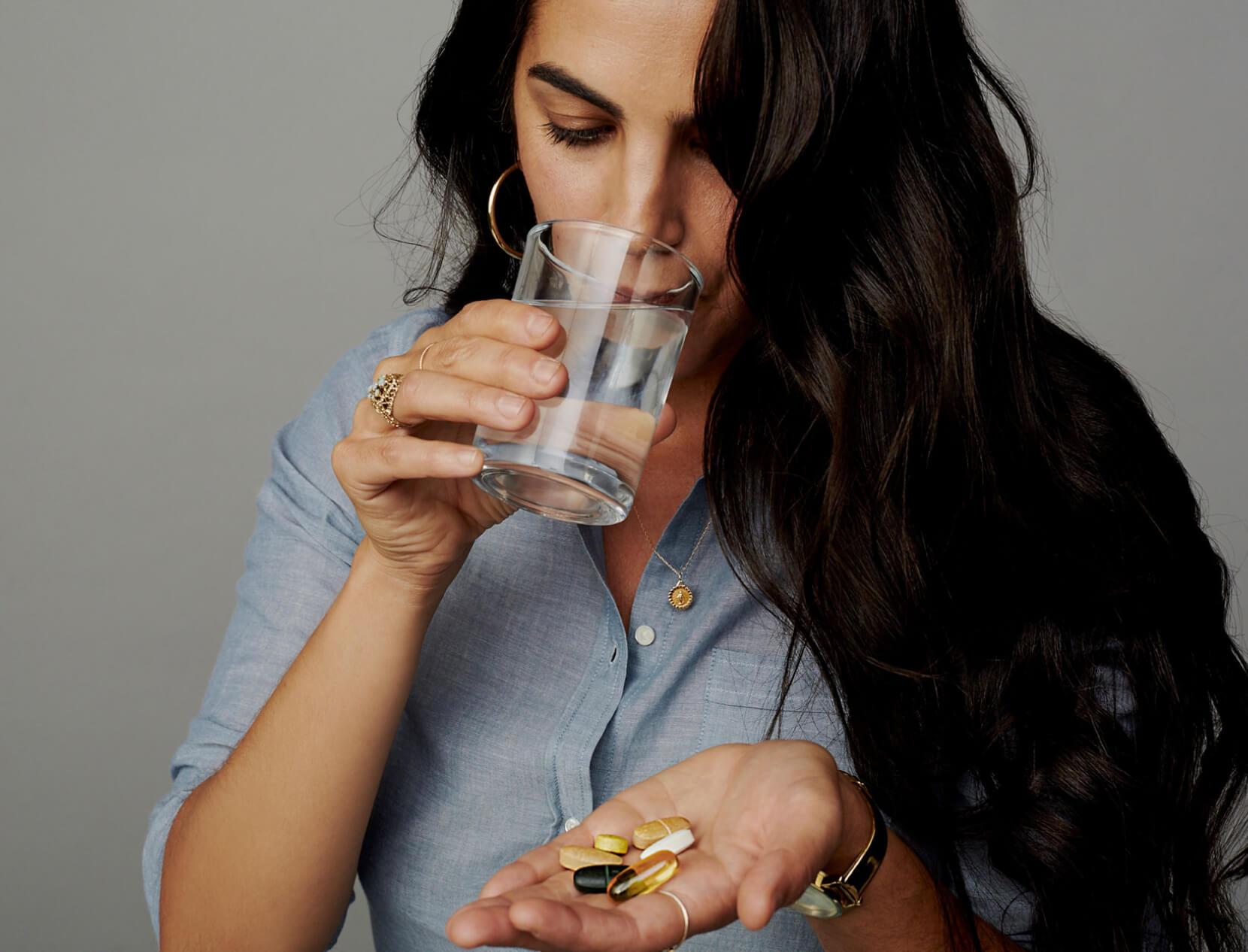 girl taking vitamins