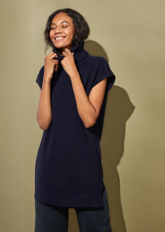 woman posing wearing g label