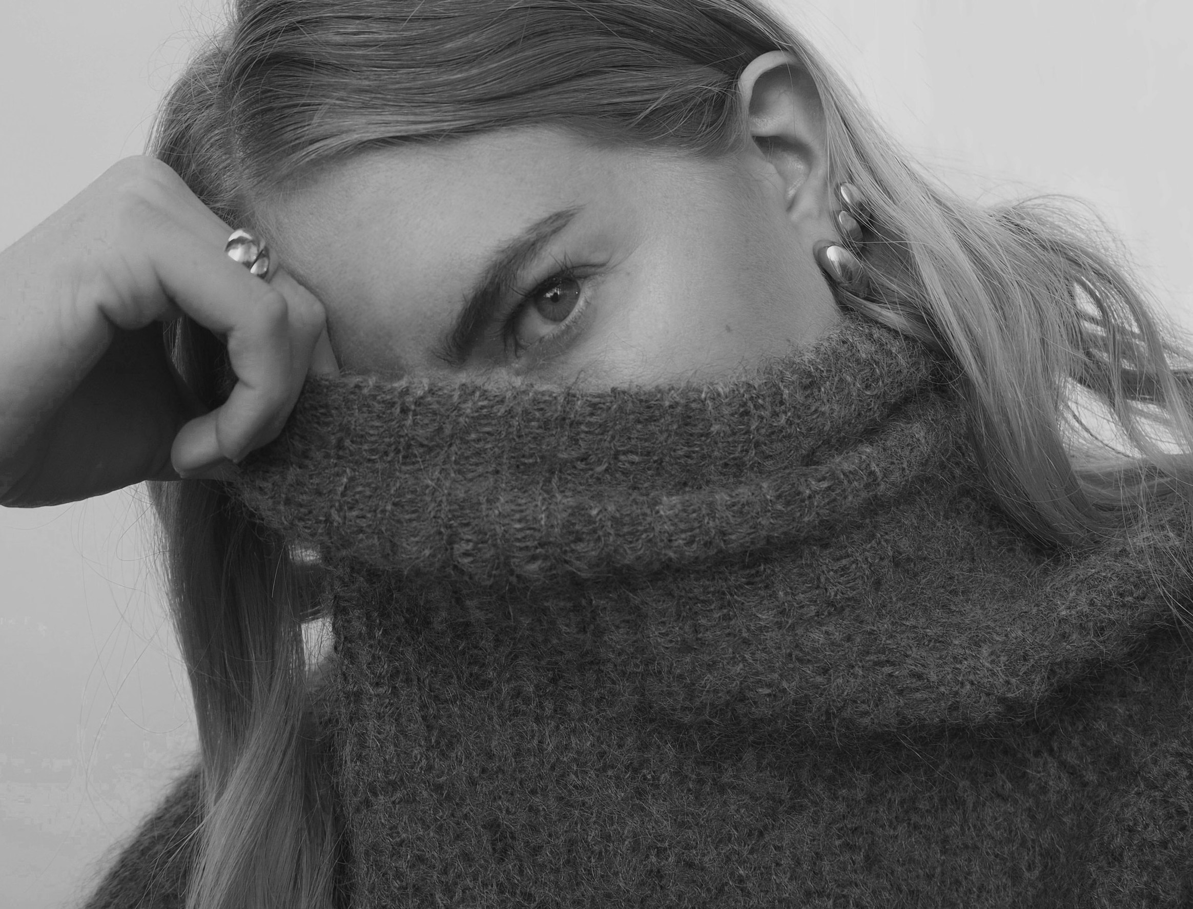 girl in turtleneck sweater
