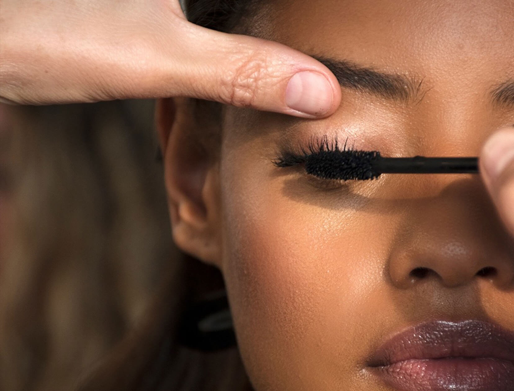 woman having mascara applied