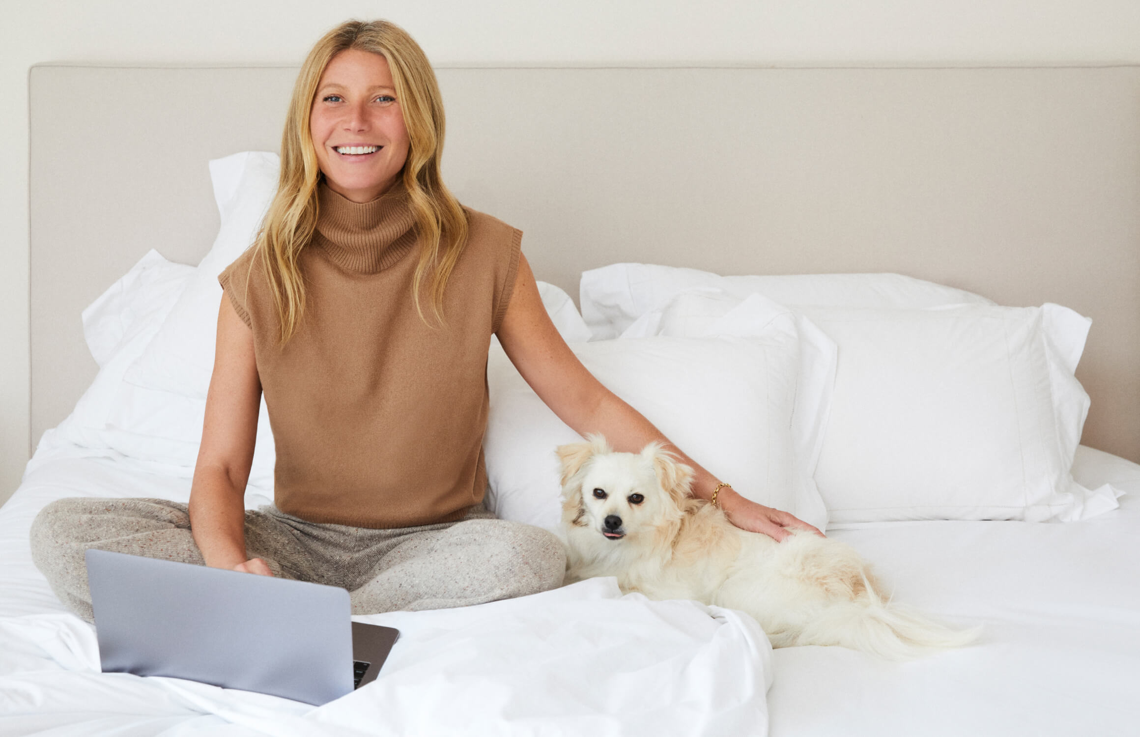 GP on a bed with a dog