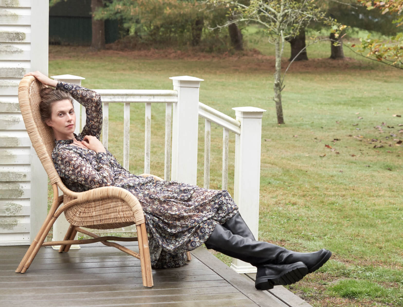 girl on porch with Stuart Weitzman boots