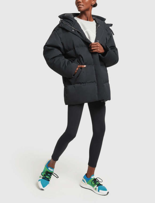 woman posing with jacket