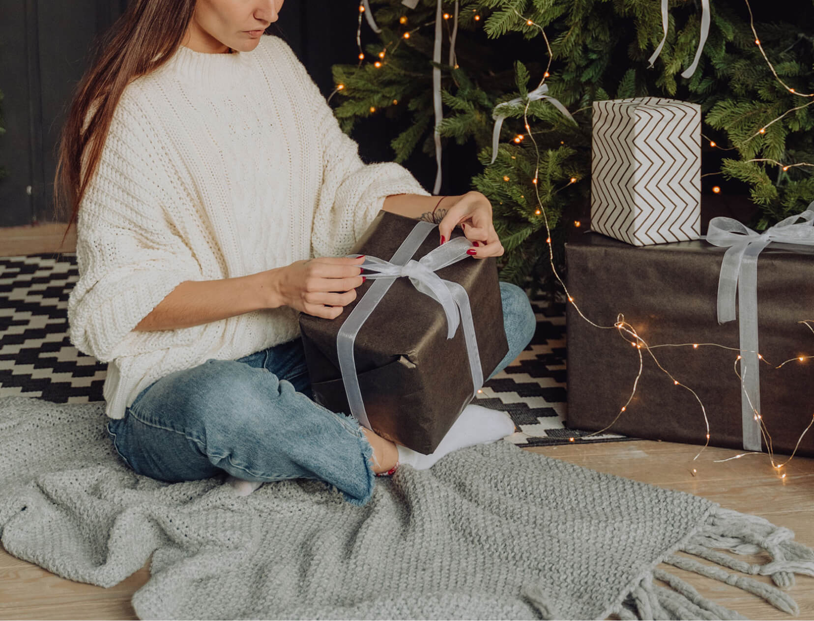 woman opening a present