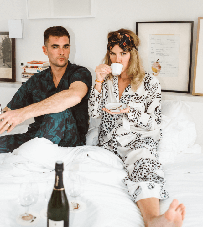 man and woman in pajamas in bed