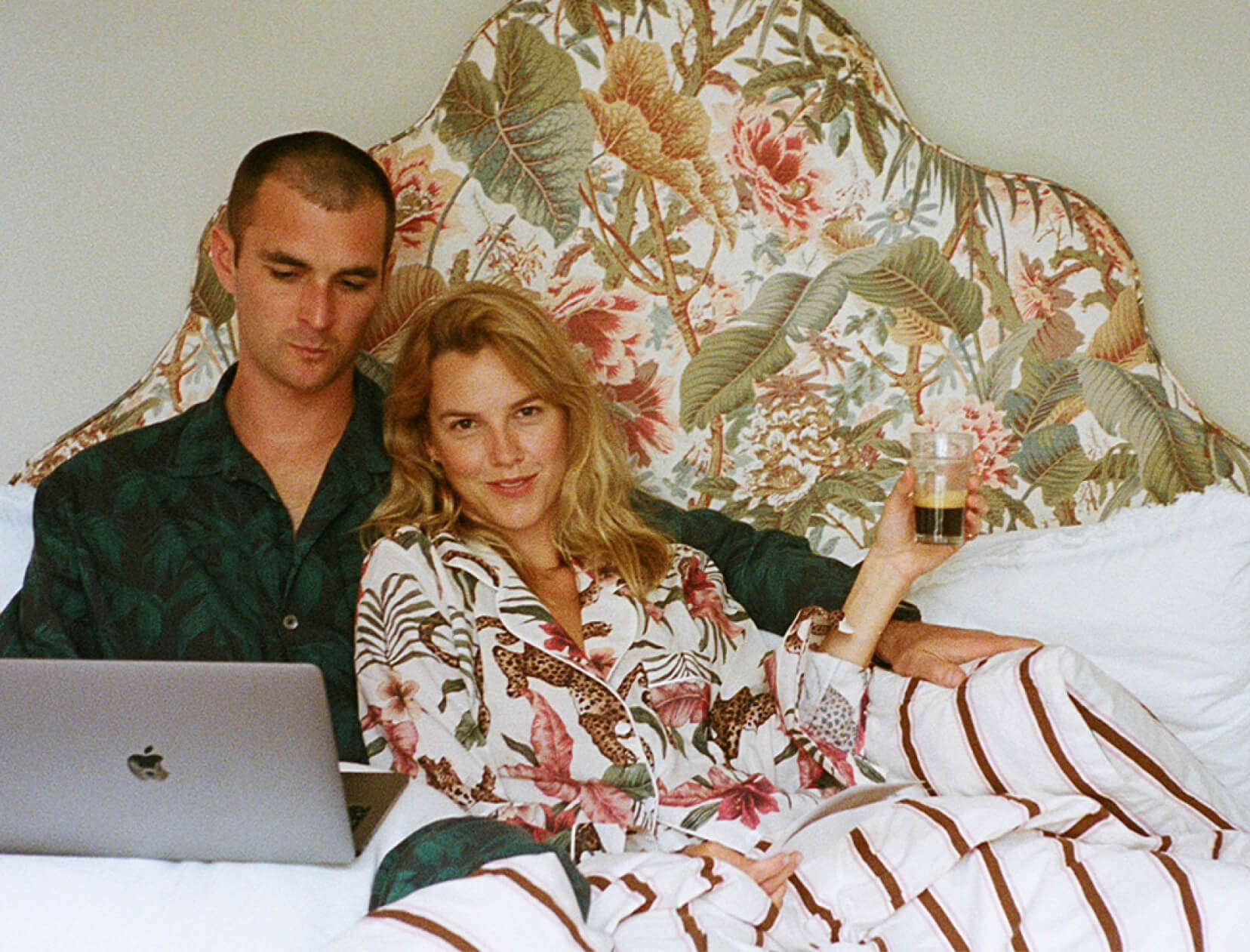 man and woman in pajamas