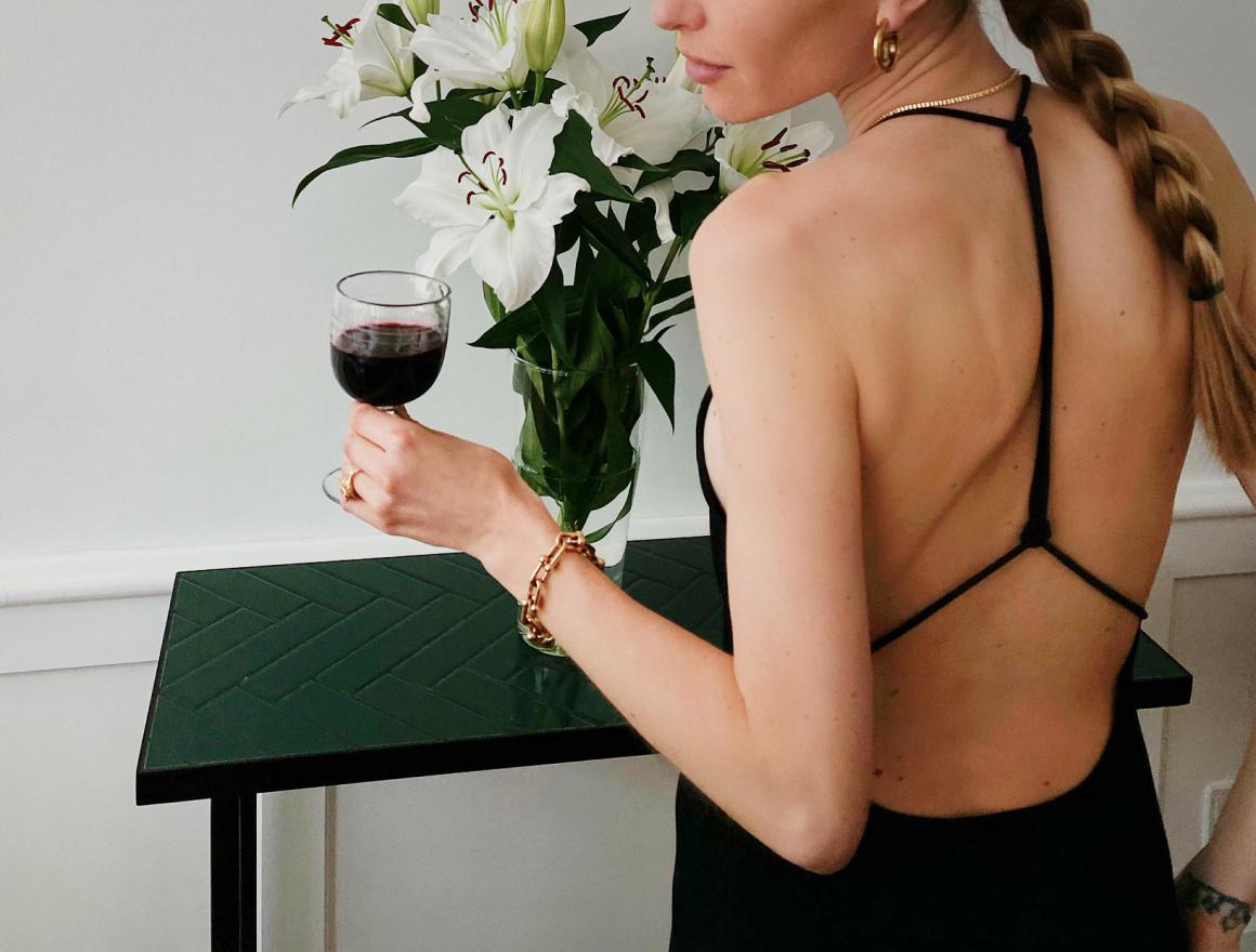 woman holding wine glass