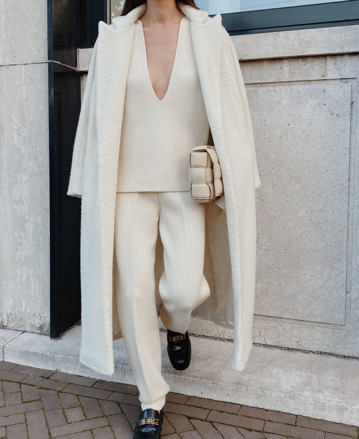 model in white tailored coat