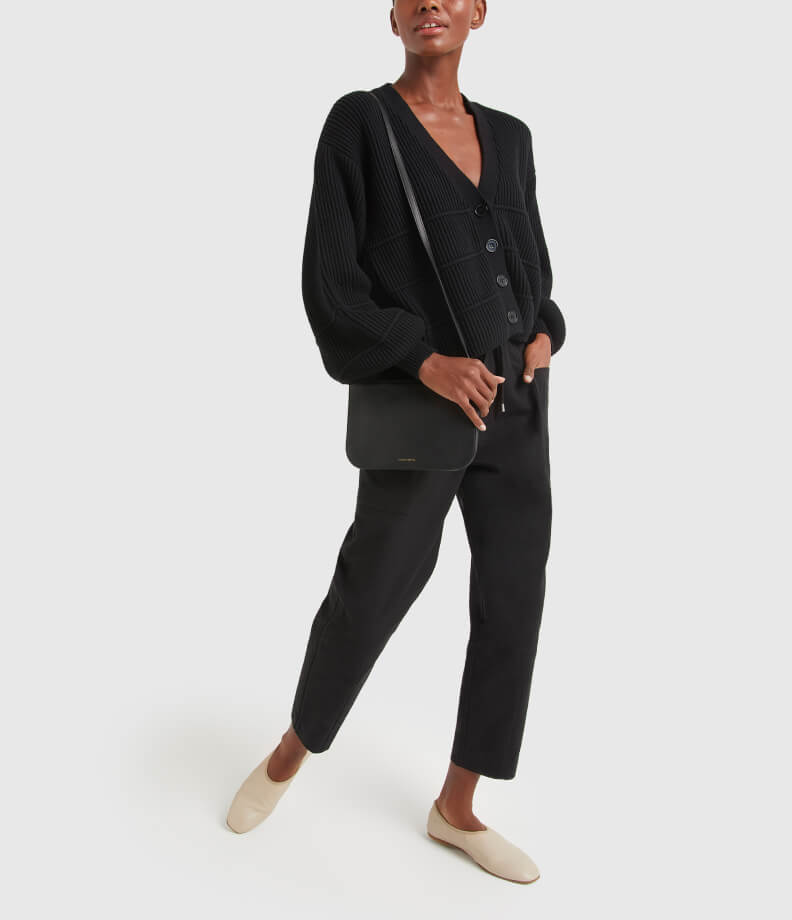 woman in blank APIECE APART CARDIGAN and PANT