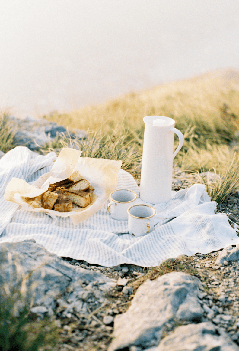 tea and cake on a picnic blanket