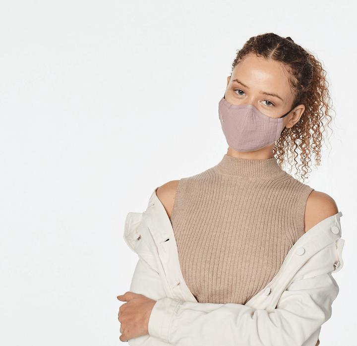 woman posing wearing a face mask
