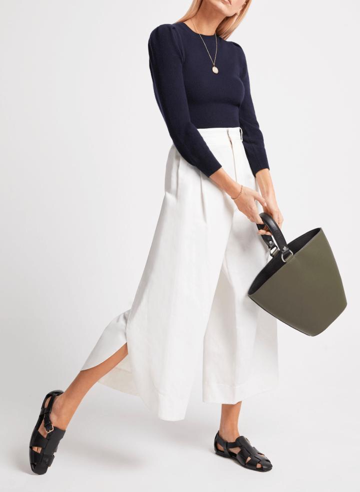 woman posing with bag