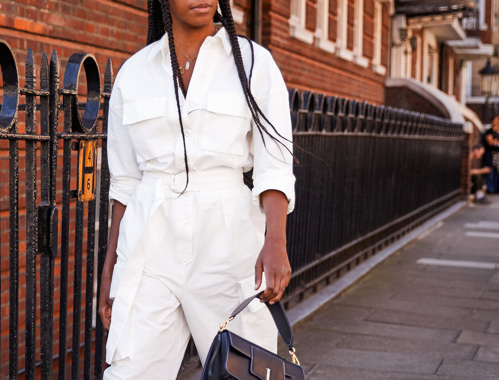 woman wearing a white jumpsuit