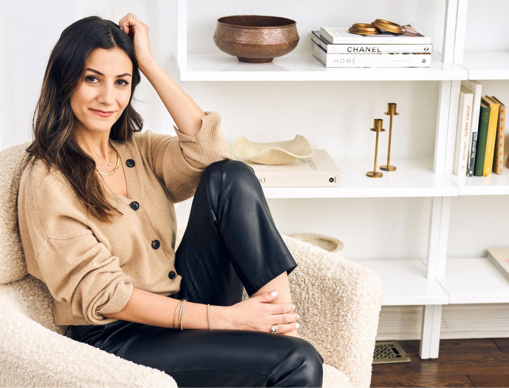 Noura Sakkijha in a chair