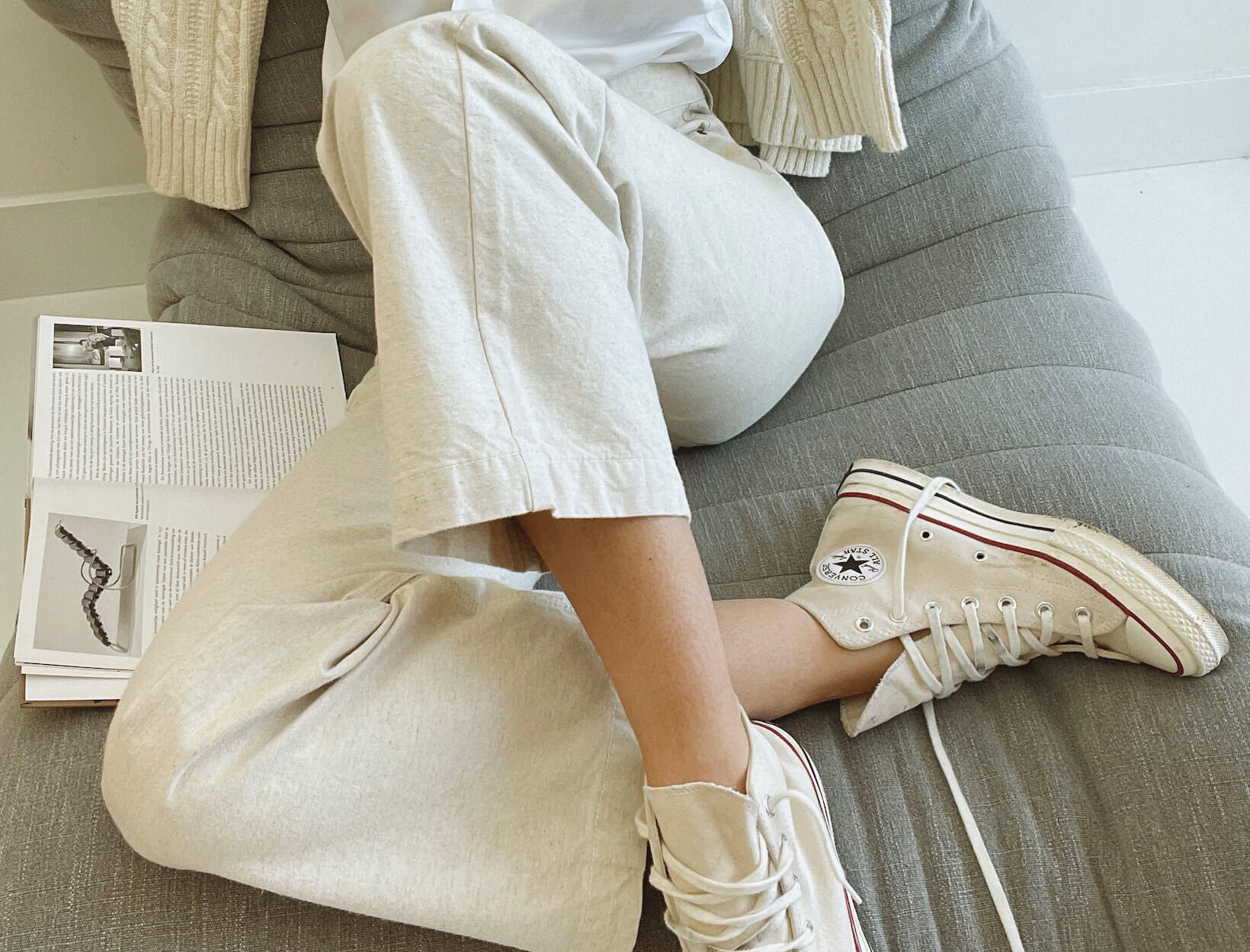 woman in neutral outfit with sneakers
