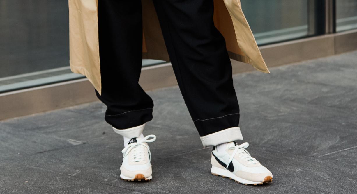 woman in nike sneakers