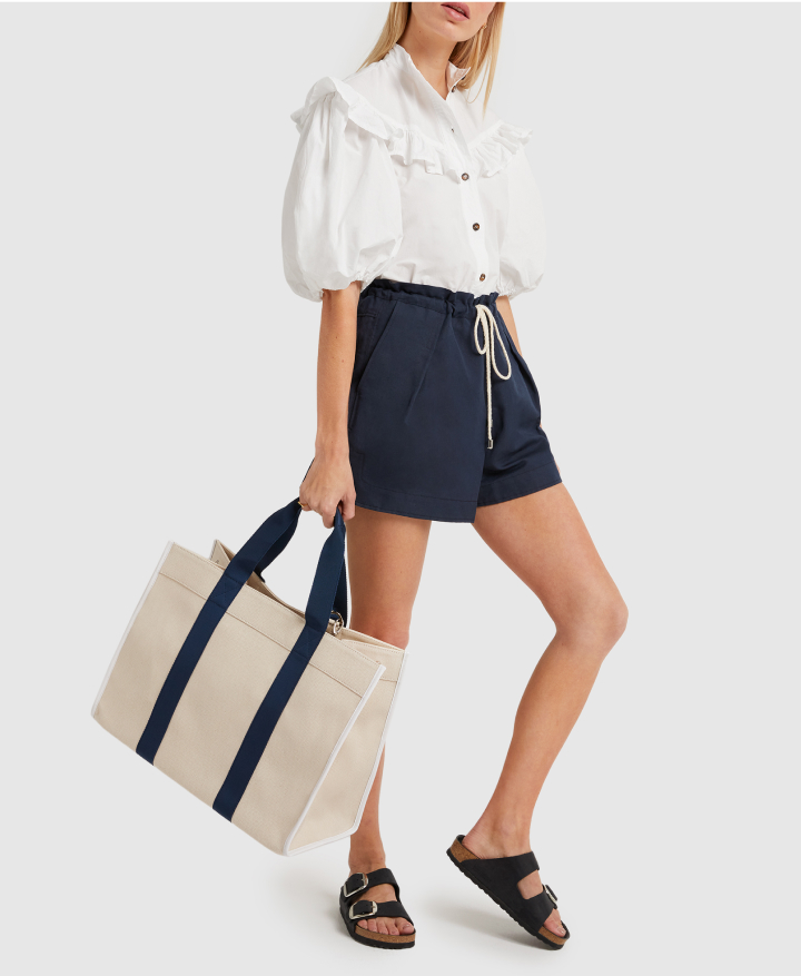 model in G. LABEL Dale Drawstring-Waist Shorts and birkenstocks