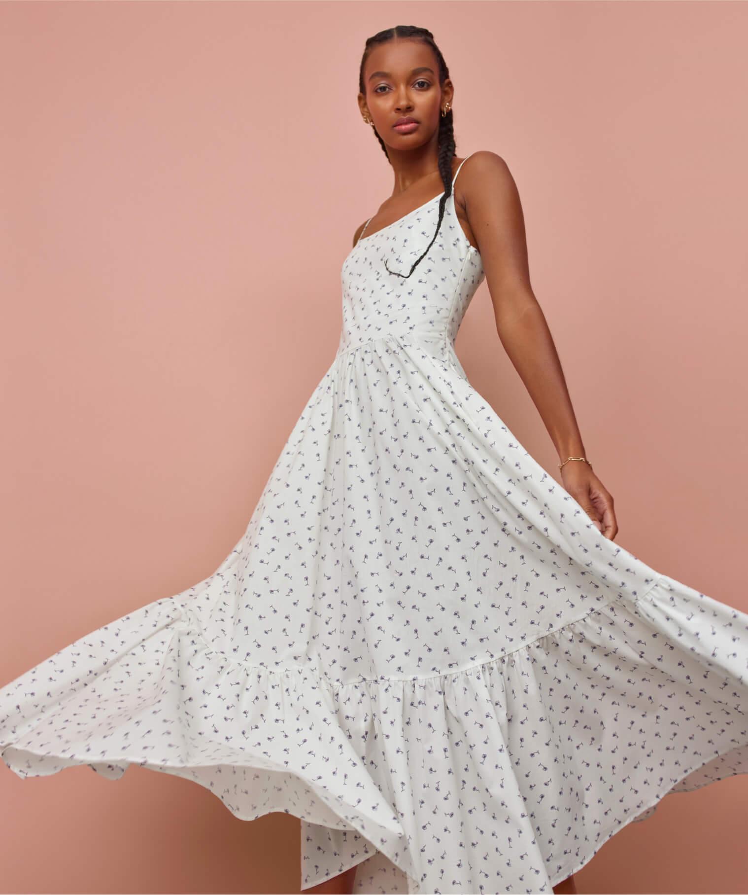 woman wearing g label theodora tea length dress