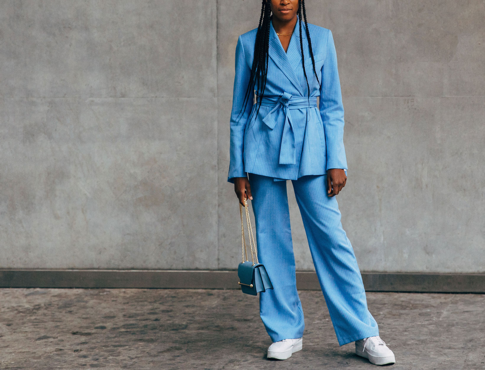 woman in a matching blue blazer and pants