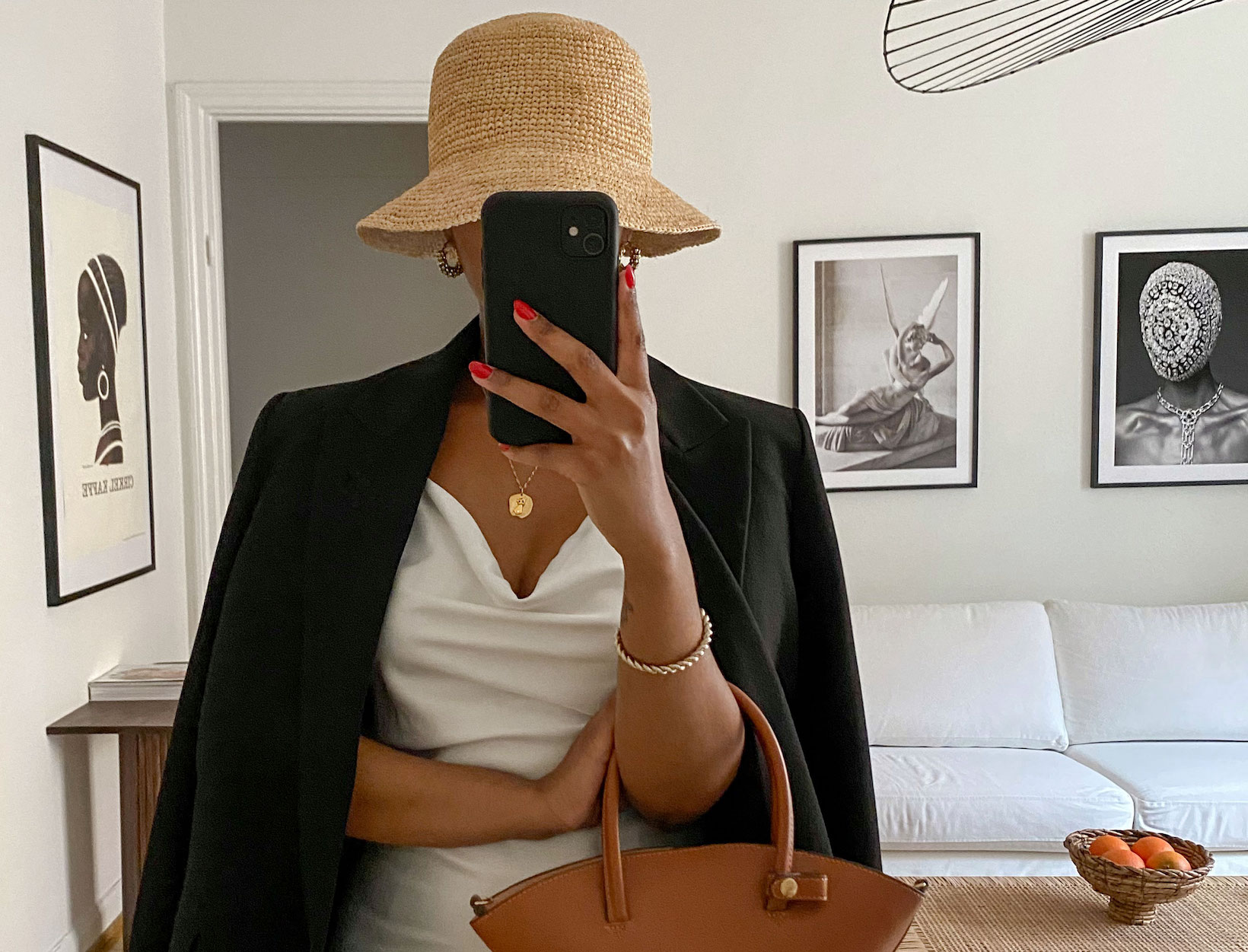 a woman with a straw hat and a leather bag