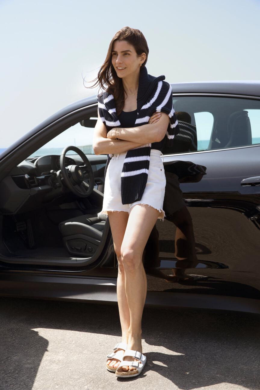 Kelly Egarian with Porsche Taycan