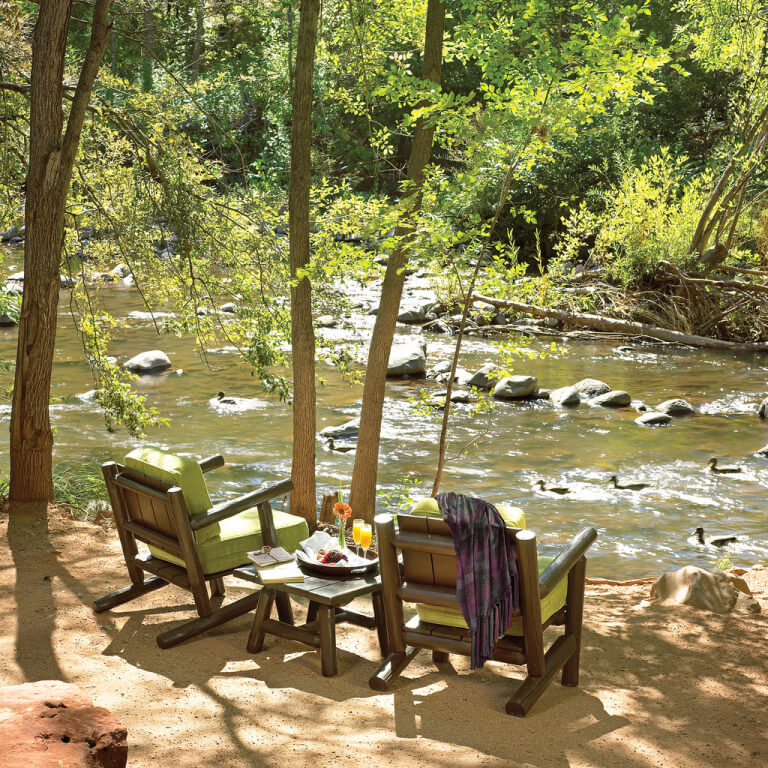 chairs by a stream
