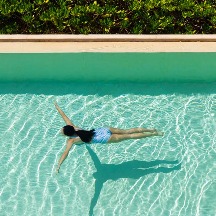woman diving in pool