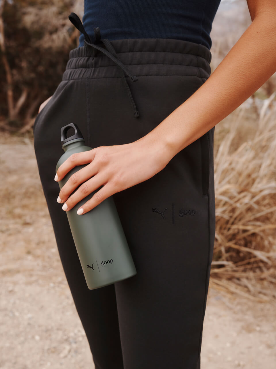 woman posing with water bottle