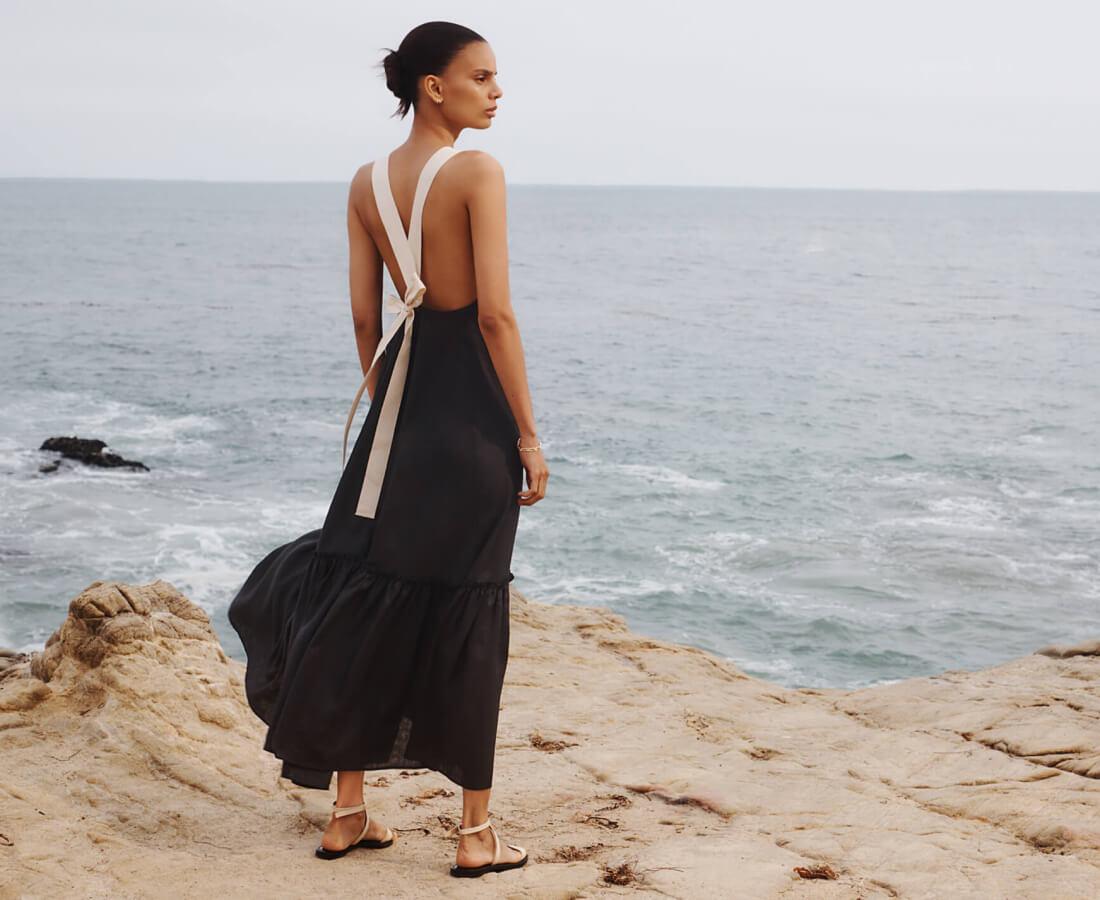 woman in g. label dress