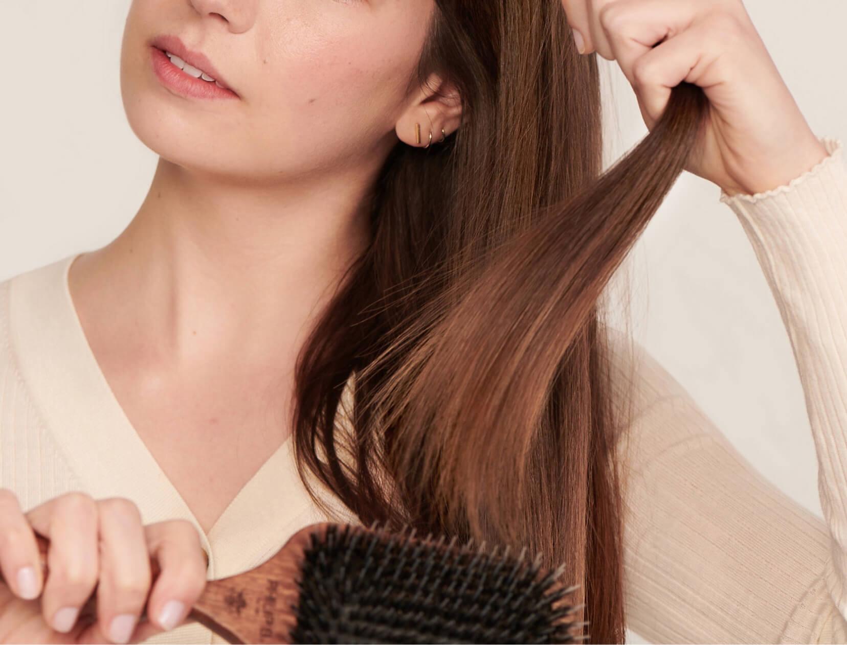 Woman brushin hair