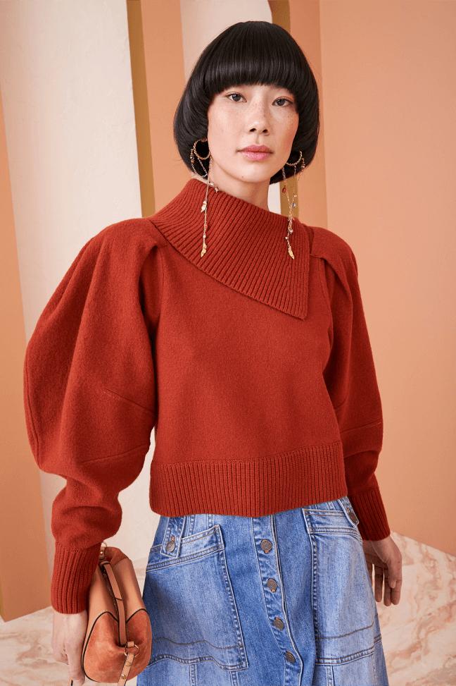 woman posing wearing an ulla Johnson pullover