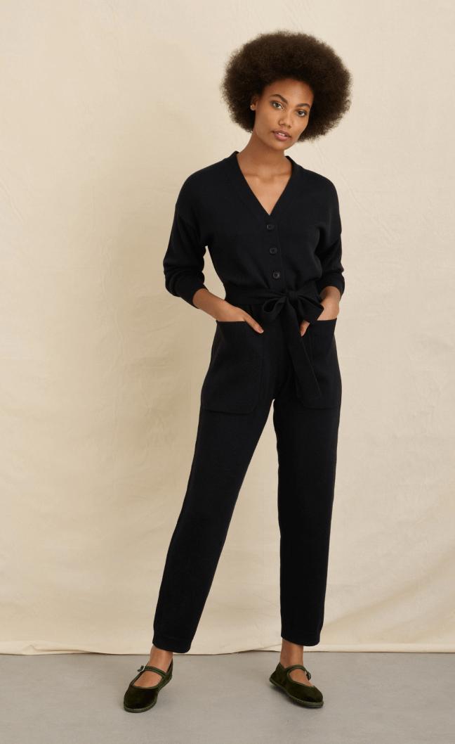 woman posing wearing alex mill jumpsuit
