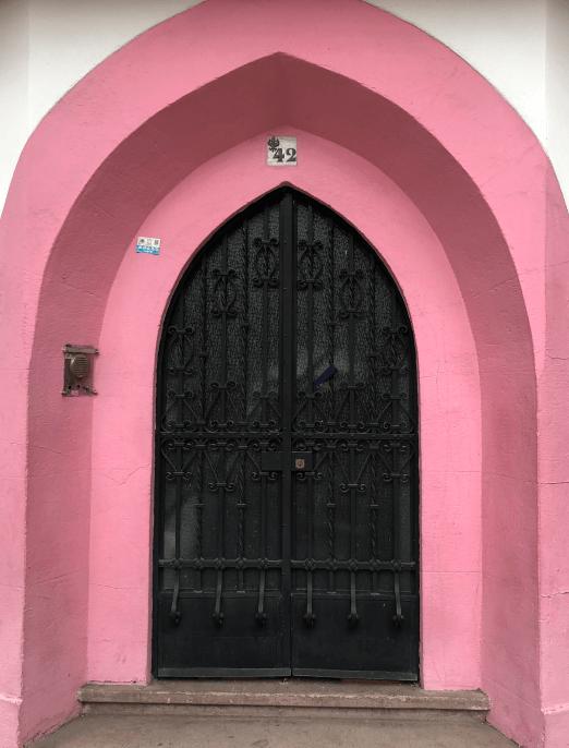 door with pink walls
