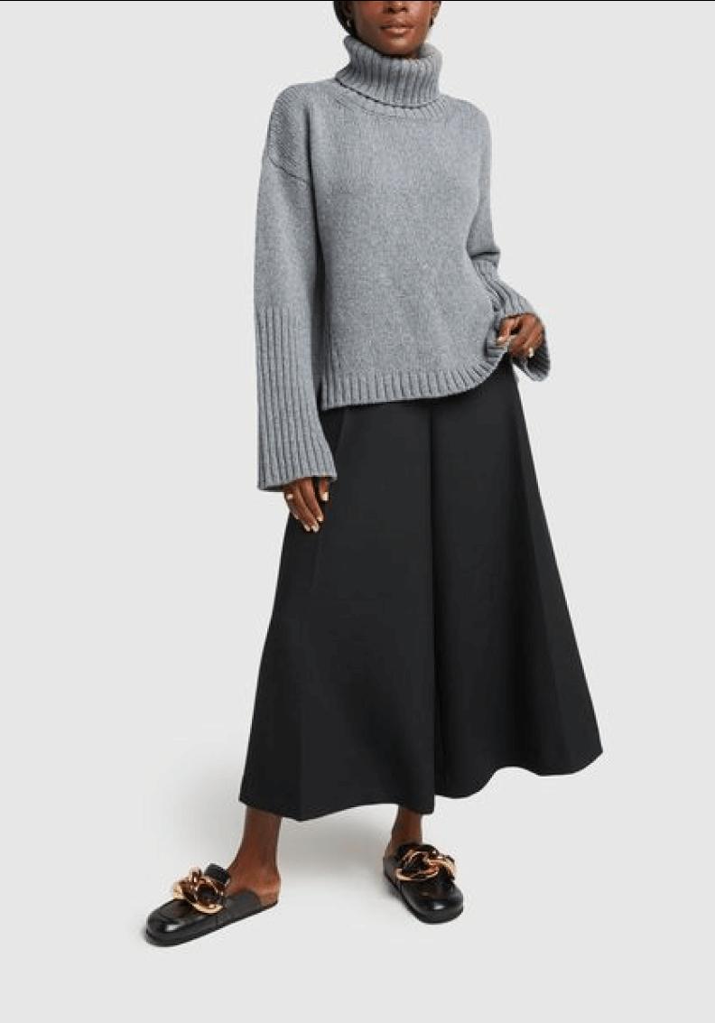 woman posing wearing G. Label