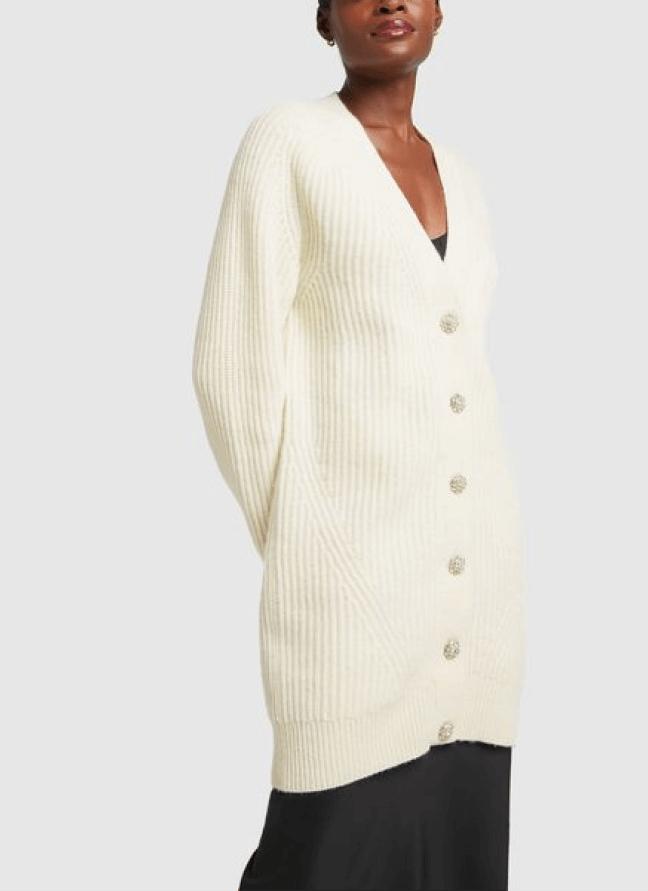 woman posing wearing a ganni cardigan