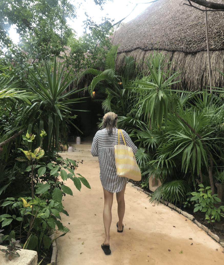 Kiki walking through a garden