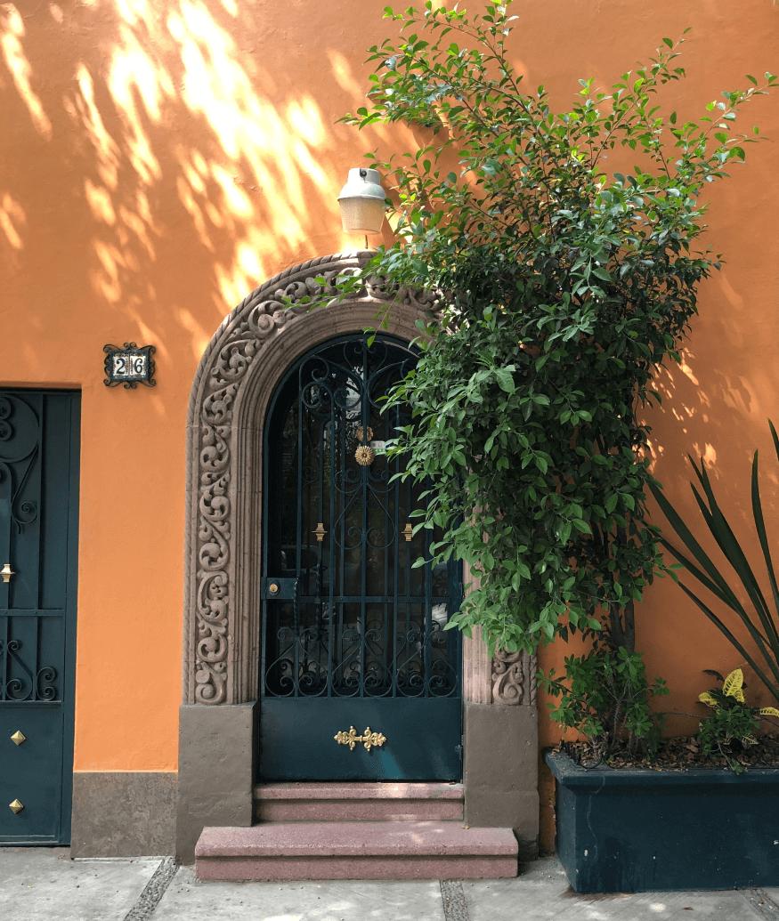 door with orange wall