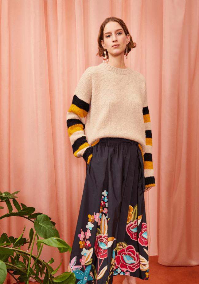 woman posing wearing a la double j sweater