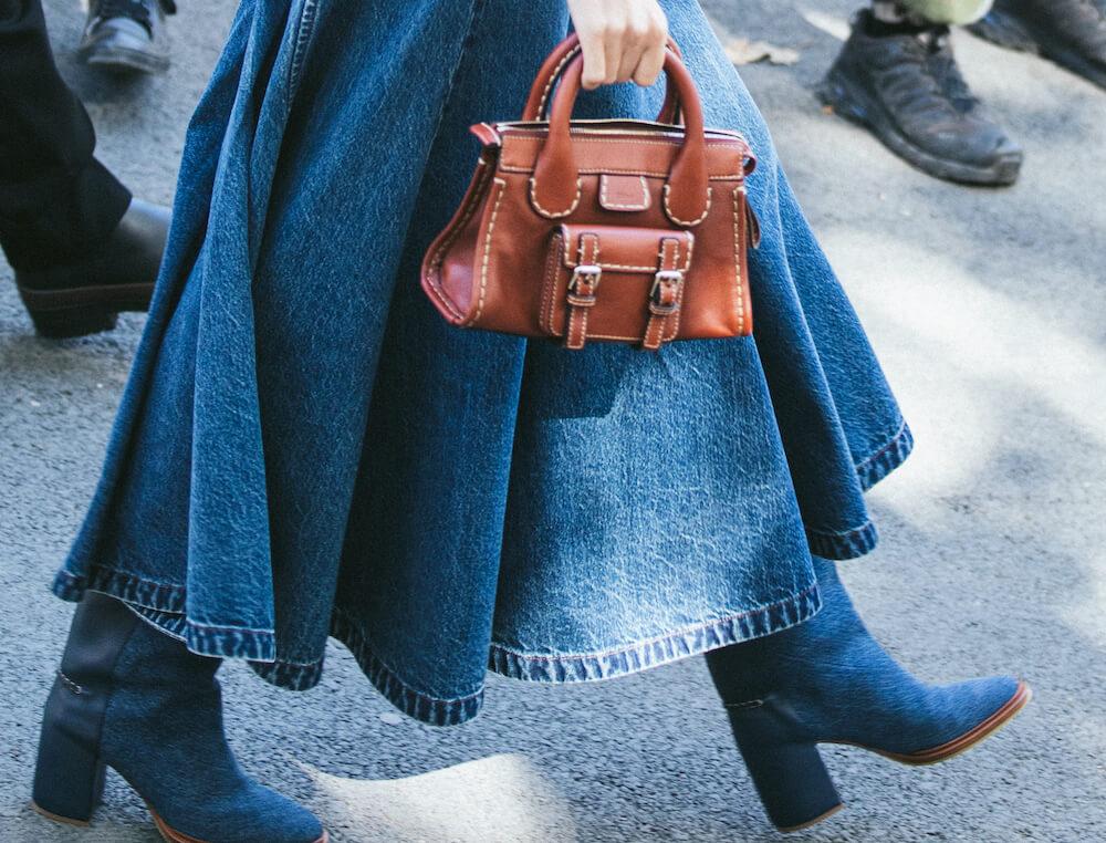 woman carrying a handbag